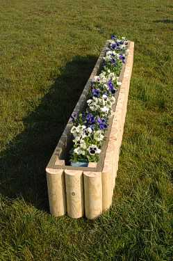 Log extender shown here filled with flowers